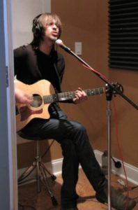 "Reggie Rueffer in the studio recording ""Exposed"" for the Heaven, a novel Soundtrack"